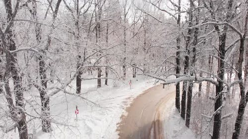 Winter Cabin House And Road In Winter Forest