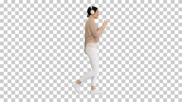 Thumbnail for Smiling female with headphones walking, Alpha Channel