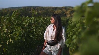 Beautiful Brunette in Green Vineyard