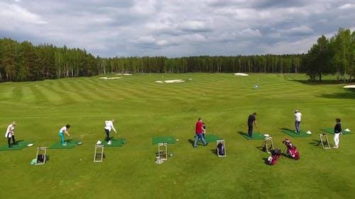 Golfers Hitting Golf Shot With Club