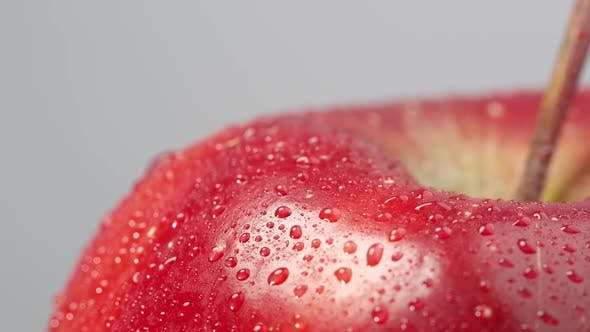 Thumbnail for Close up of a red apple spinning with water on it