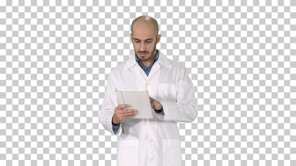 Mature Male Doctor Holding Digital Tablet Using It and Walking