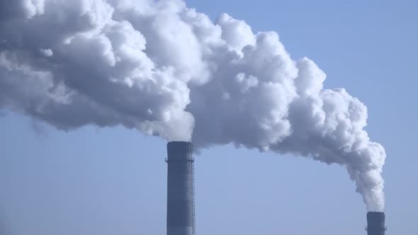 Thumbnail for Smoke From the Chimneys Plant Rises Into the Clouds