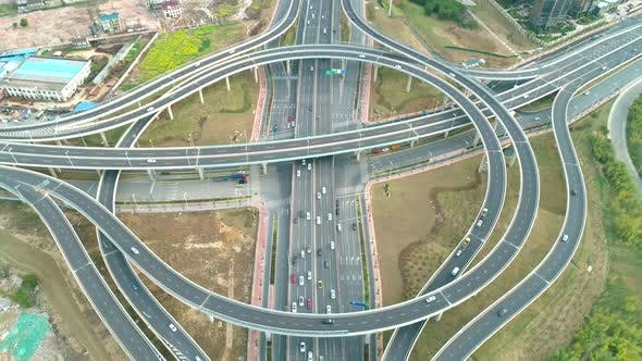 Thumbnail for Top View To the Cars Driving on Multi-level Highway on the Sunset. Highway Multilevel Junction Road