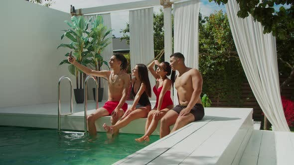 Thumbnail for Happy Multiracial Friends Taking Selfie at Poolside