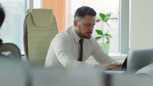 Thumbnail for Man Focusing on Work and Typing on Computer
