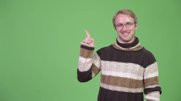 Thumbnail for Studio Shot of Happy Handsome Man Pointing Up