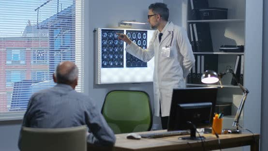 Thumbnail for Male Doctor Explaining Brain Scan To Patient