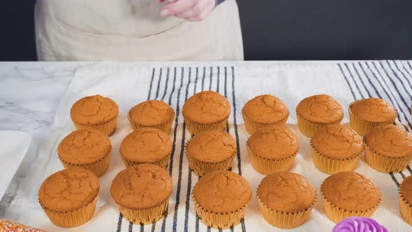 Thumbnail for Piping Italian buttercream frosting on top of pumpkin spice cupcake