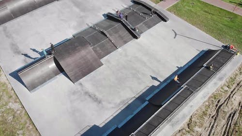 Aerial drone view of skate park with skateboarders
