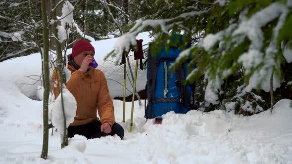 Thumbnail for Tourist Resting in the Winter Forest