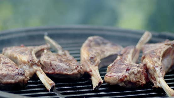 Lamb Rack on a Barbecue with Smoke.