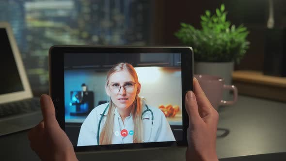 Tablet Screen with Female Doctor Video Calling