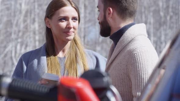 Thumbnail for Man and Woman Talking at Gas Station