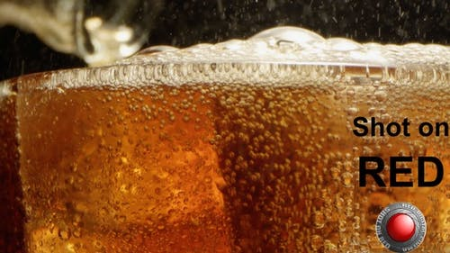 Refreshing Cola Drink With Bubbles and Ice Cubes