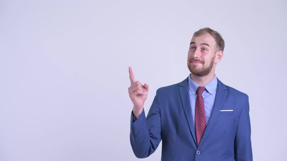 Happy Bearded Businessman Thinking and Pointing Up