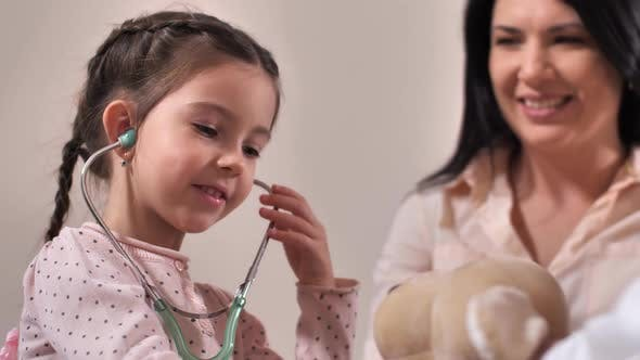 Thumbnail for Cute Girl Using Stethoscope in Doctor's Office