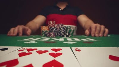 Close Up of Man Playing Card Game in Casino