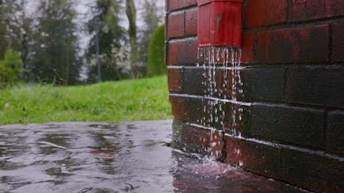 Rain Water Flows From the Gutter Slowmotion