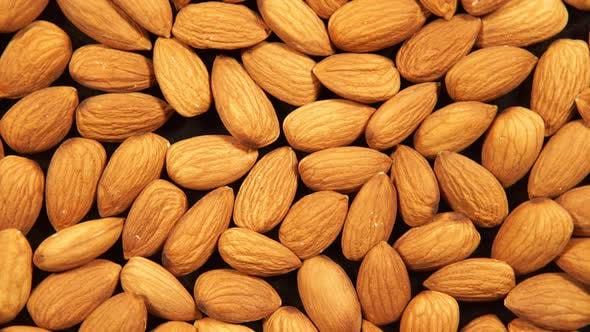 Thumbnail for Peeled almonds kernels is circling