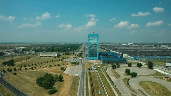 Aerial View, Factory Area of the City, Highways and Streets, Cars Are Parked Near the Building. High