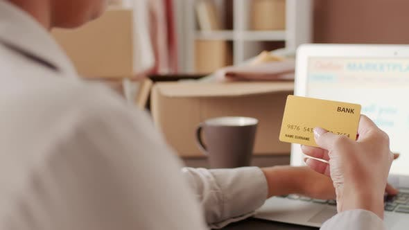 Woman Buying Online and Paying with Debit Card