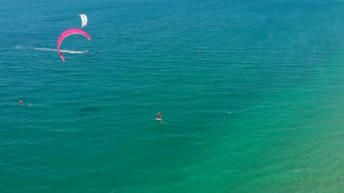 Acrobatic Jump of Professional Kite Surfer on the Sea Wave, Athlete Showing Sport Trick Jumping with
