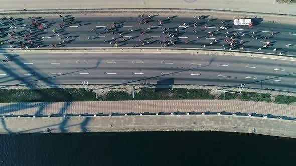 Thumbnail for Marathon Running Along Seafront at Morning. Top View Shot