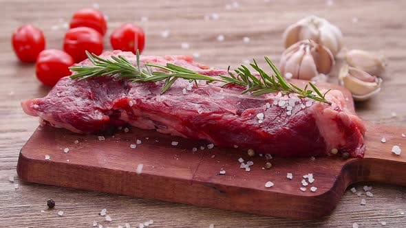 Cooking Concept. Raw Beef Steak on a Wooden Table