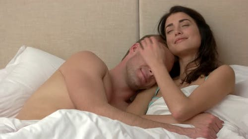 Couple Lying in Bed.