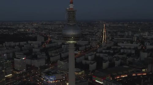 AERIAL: Over Berlin Germany TV Tower Alexanderplatz at Night with City Lights Traffic