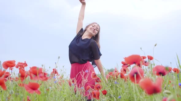 Thumbnail for Pretty Young Woman Dancing in a Poppy Field Smiling Happily