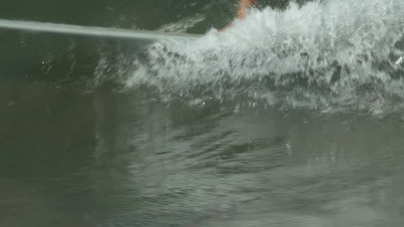 Thumbnail for A male surfer rides a wave on a longboard surfboard.