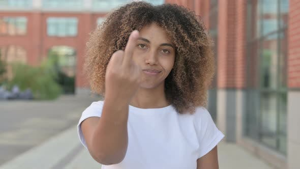 Angry African Woman Showing Middle Finger Sign
