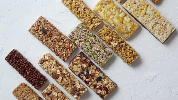 Thumbnail for Row of Mixed Gluten Free Granola Cereal Energy Bars, With Dried Fruits and Nuts