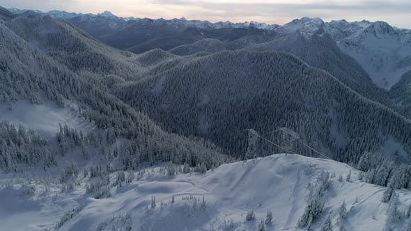 Thumbnail for Utility Company Electric Power Lines Aerial In Snowy Mountains