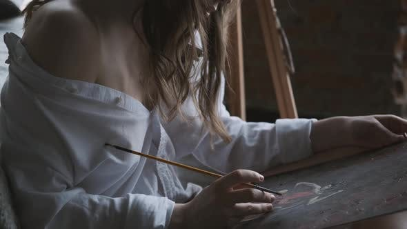 Thumbnail for Girl Painter Paints a Picture in the Home Studio.