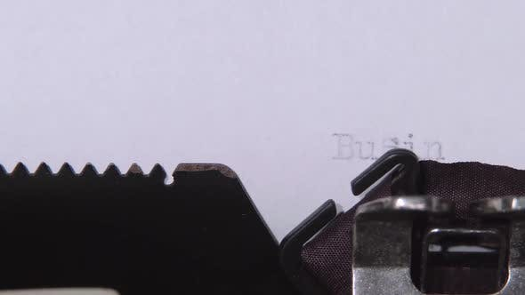 Thumbnail for Word Business Plan Printed on a Retro Typewriter. Close Up