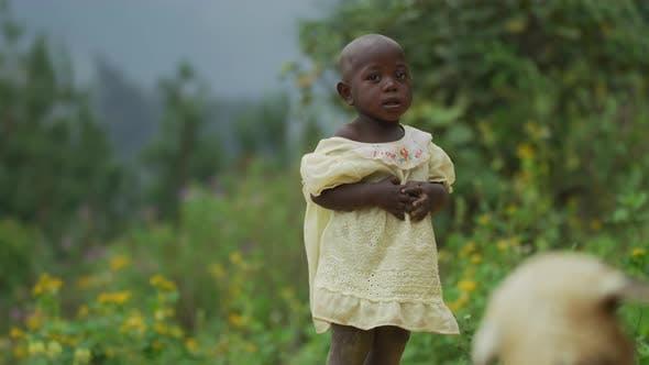 Thumbnail for African girl wearing a light yellow dress