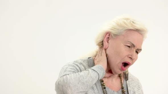 Senior Woman Has Neck Ache