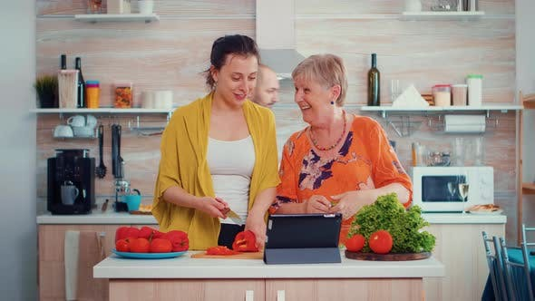Thumbnail for Women Cooking Using Tablet