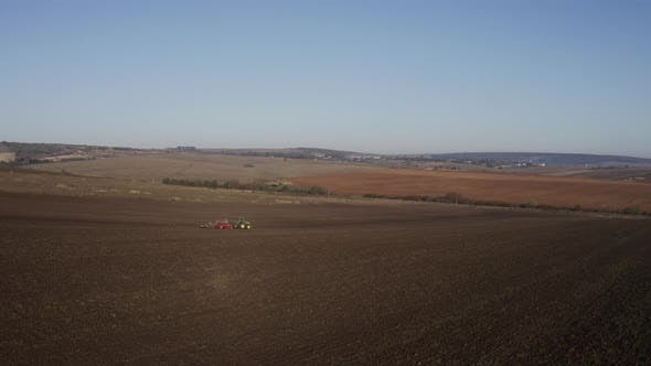 Cover Image for Fields. Tractor Driving Across The Field.