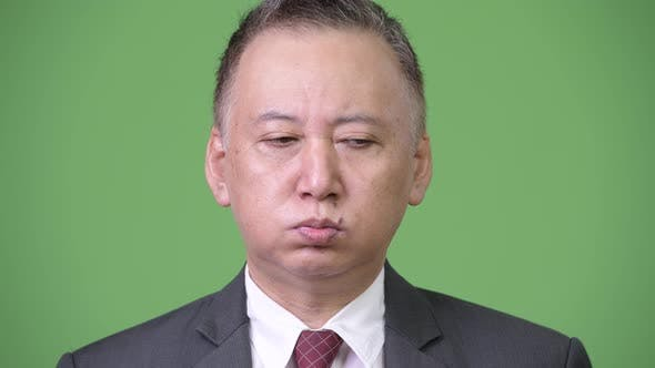 Thumbnail for Mature Japanese Businessman Looking Tired and Bored