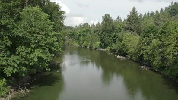 Cover Image for Aerial Flight Above Snoqualmie River Washington State   Drone Angle