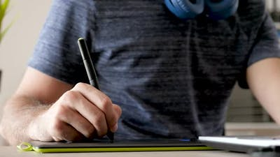 Graphic Artist Drawing on a Digital Tablet