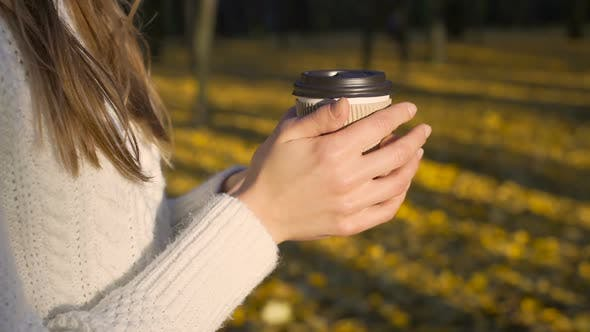 Cover Image for Lonely Girl Sipping Coffee in Beautiful Autumn Park, Enjoying Solitude, Inspired