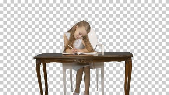 Cute little girl doing homework, writing down, Alpha Channel