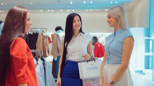 Girlfriends Pick Clothes in a Boutique
