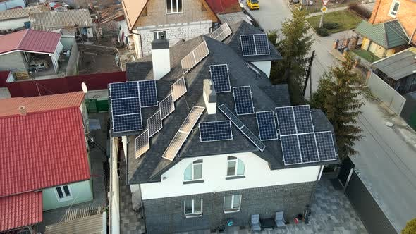 Aerial View of Photovoltaic Solar Panels on the Roof of a Building for Renewable Energy