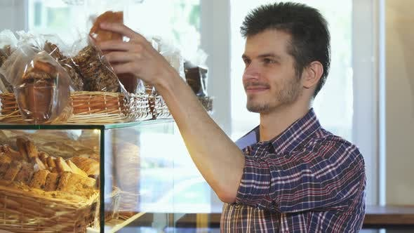 Thumbnail for Attractive Young Man Buying Cookies at the Bakery